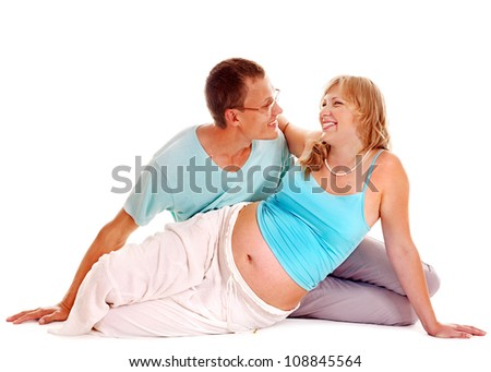 Happy pregnant woman with man.  Isolated.