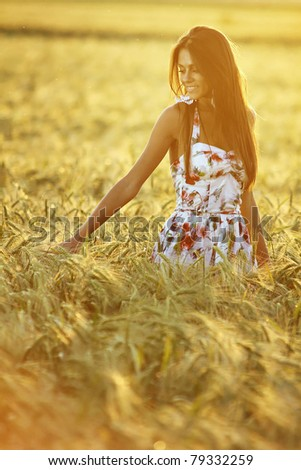 Happy pretty girl in field at sunset .Art photo