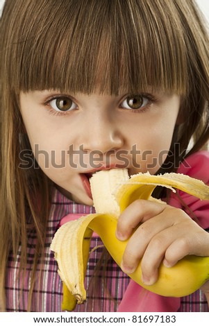 happy pretty girl with banana on white background