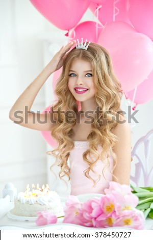 Happy pretty girl with cream cake at birthday party. Happy girl with pink balloons smiling and laughing. Barbie style