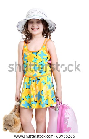 happy pretty little girl with touristic bags