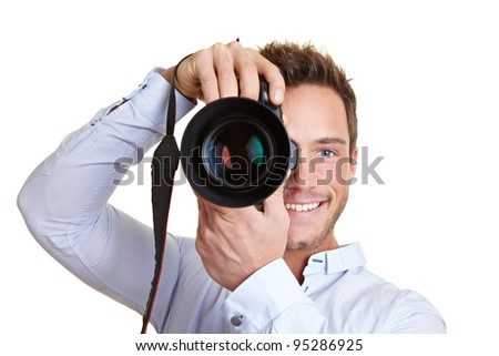 Happy professional photographer with digital DSLR camera