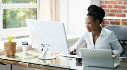 Happy Professional Woman Employee Using Computer For Work