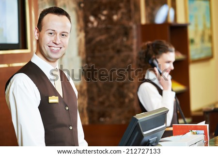 Happy receptionist worker standing at hotel counter #212727133