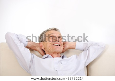 Happy relaxed elderly man at home #85782214