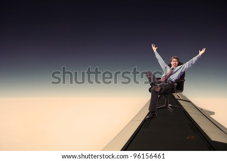 Happy relaxing businessman flying. Over blue sky. #96156461
