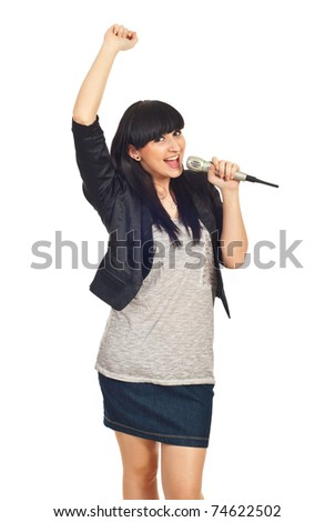 Happy rock girl sing in microphone and raising her arm isolate don white background