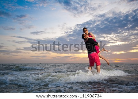 Happy Romantic Couple Scene of love Sunset at the Beach