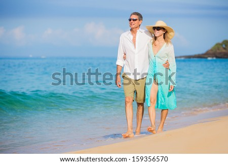 Happy Romantic Couple Walking on the Beach