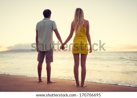 Happy Romantic Couple Watching the Sunset Holding Hands on Tropical Beach Vacation, Vintage Trendy Color Styling