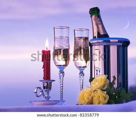 happy romantic dinner with white wine on the sky background