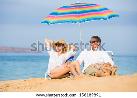 Happy Romantic Middle Age Couple Relaxing on Tropical Beach, Vacation Concept