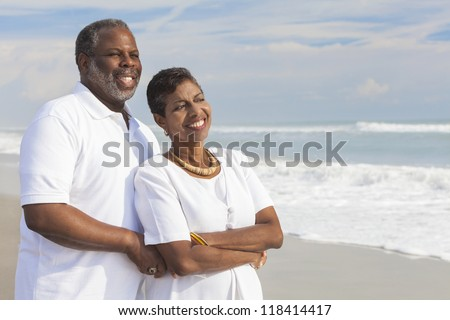 Happy romantic senior African American man and woman couple on a deserted tropical beach
