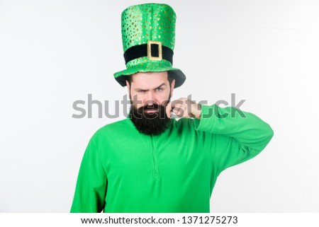 Happy saint patricks day. Hipster in leprechaun hat and costume. Bearded man celebrating saint patricks day. Irish man with beard wearing green. He has moustache.