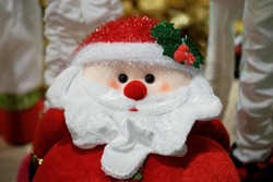 Happy Santa Claus Doll on Christmas time.colorful bokeh background.