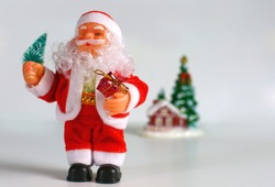Happy Santa Claus Doll on Christmas time.colorful bokeh background