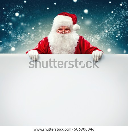 Shutterstock Happy Santa Claus holding blank advertisement banner background with copy space. Smiling Santa Claus pointing in white blank sign. Christmas theme, sales