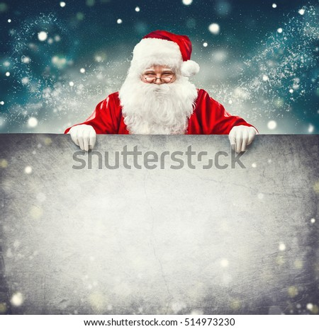 Happy Santa Claus holding blank advertisement banner background with copy space. Smiling Santa Claus pointing in white blank sign. Christmas theme, sales #514973230