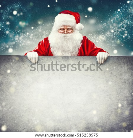 Happy Santa Claus holding blank advertisement banner background with copy space. Smiling Santa Claus pointing in white blank sign. Christmas theme, sales #515258575