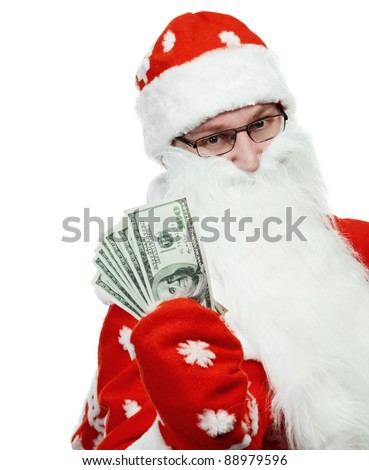 Happy Santa Claus man in red hat holding dollar banknotes money