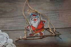 Happy Santa Claus on a swing. Paper drifts Decorations for the New Year. Holidays. Ideas To Capture the Festive Mood of The Winter Season. Festive background for creativity. Magic time