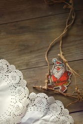 Happy Santa Claus on a swing. Paper drifts. Decorative snow. Festive decorations for the New Year. Holidays. Ideas To Capture the Festive Mood of The Winter Season. Festive background for creativity