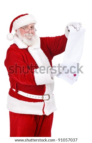 happy Santa Claus with letters and list reading wishes  of children, isolated on white background