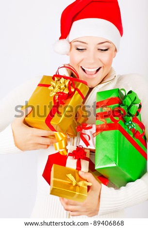 Happy Santa girl holding colorful Christmas gifts, Christmastime fun and joy, celebration of winter holidays, diversity of presents