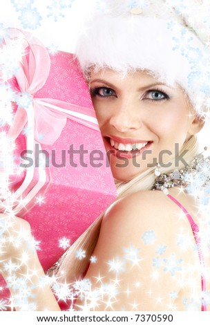 happy santa helper girl with pink gift box and snowflakes - stock photo