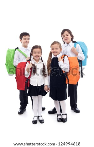 Happy school kids, boys and girls with colorful bags - isolated