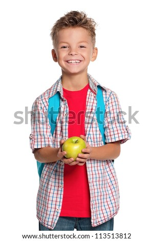 Happy schoolboy with backpack and apple isolated on white background