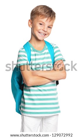 Happy schoolboy with hands folded isolated on white background