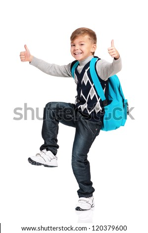 Happy schoolboy with thumbs up isolated on white background