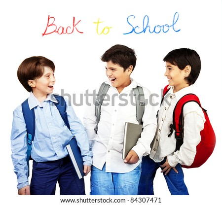 Happy schoolboys laughing, back to school, holding books and talking, isolated on white background, teenage education concept - stock photo