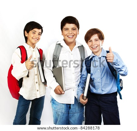 Happy schoolboys with thumbs up, back to school, boys holding books and smiling, isolated on white background, teenage education concept
