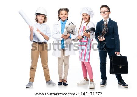 happy schoolchildren in costumes of different professions isolated on white #1145171372