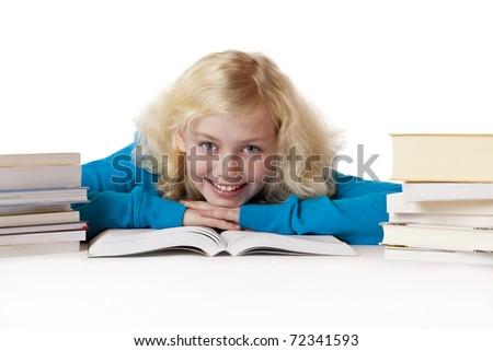 Happy schoolgirl lying on floor learning for school .Isolated on white background.