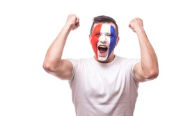 Happy screaming  France football fan of fortune win of the match of France national  team.  Big smile,scream, Hands over head. European  football fans concept.