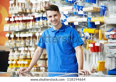 Happy seller assistant man in DIY hardware or home improvement store #118194664