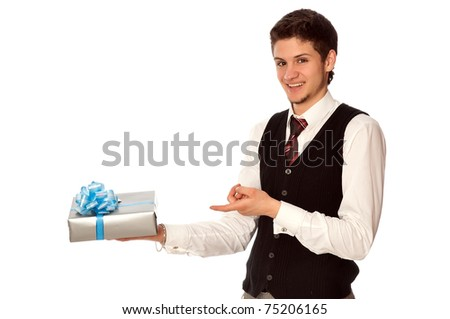 happy seller holding in the hands the gray box with blue ribbon as a gift - stock photo