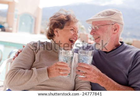 Happy Senior Adult Couple Enjoying Drinks Together.