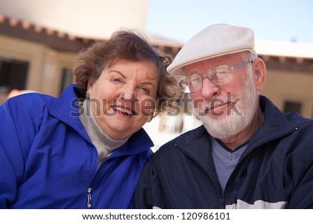 Happy Senior Adult Couple Portrait Bundled Up Outdoors.