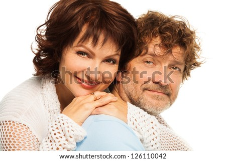 Happy senior adult couple with wife hugging husband isolated on white