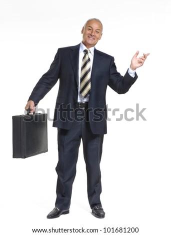 Happy senior businessman holding a suitcase on white background.