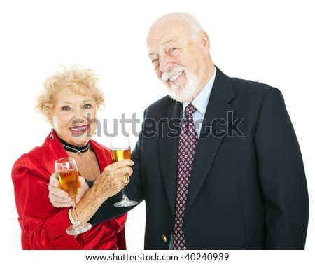 Happy senior couple celebrating New Years or other holiday with champagne.  Isolated on white.