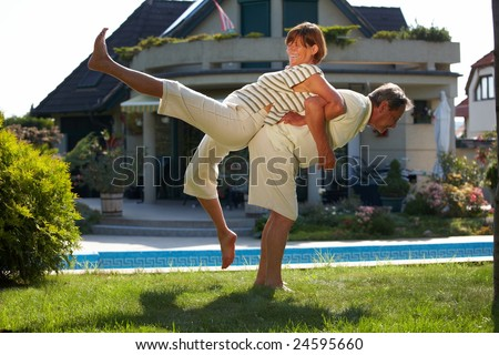 Happy senior couple doing workout exercise at home, outdoor, smiling.