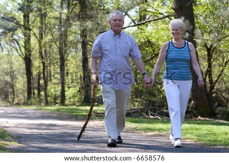 Happy senior couple enjoying a walk in the parc