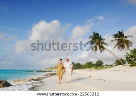 Happy senior couple enjoying retirement on tropical destination: Maria la Gorda beach on caribbean island Cuba