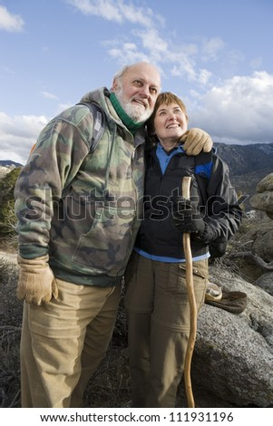 Happy senior couple hiking