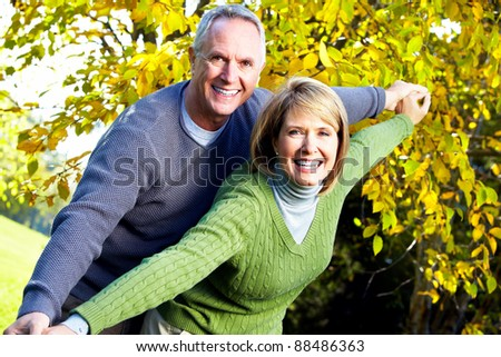 Happy senior couple in love at the park.